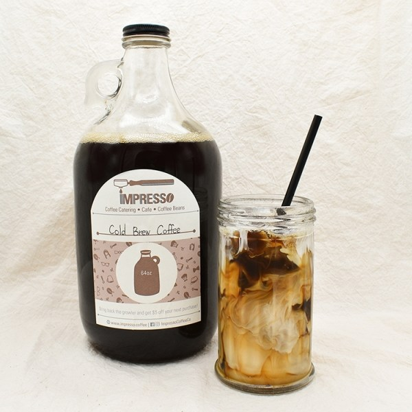 A growler filled with iced coffee and a glass of iced coffee with cream