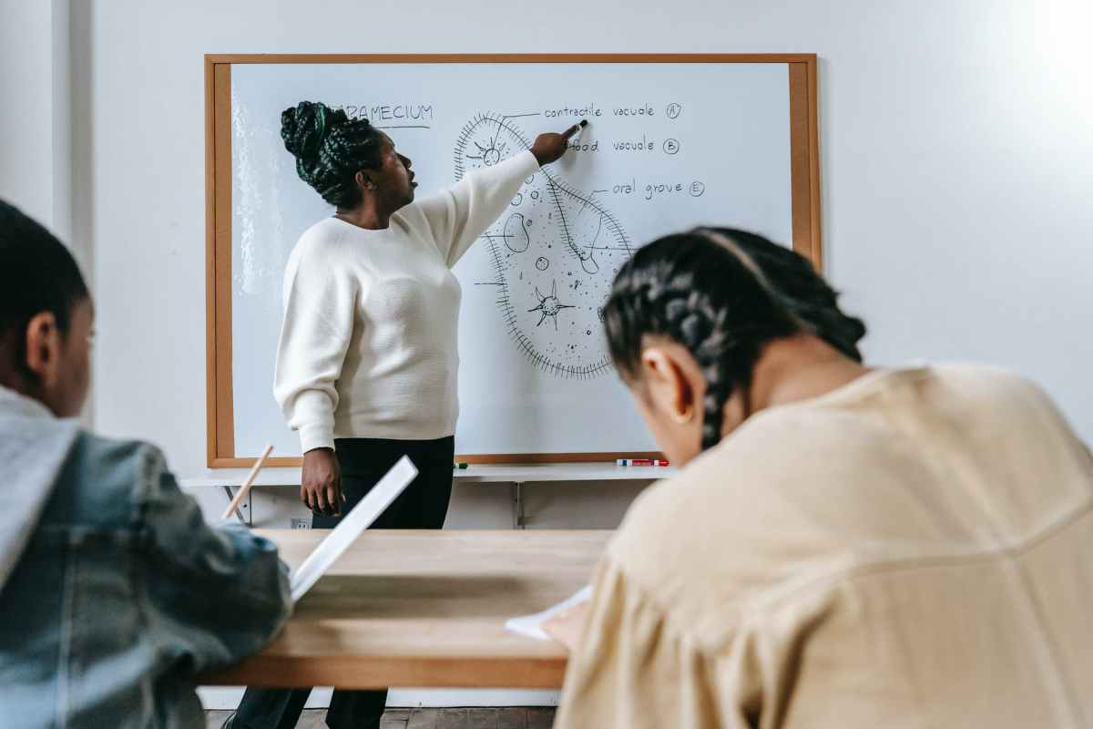 black woman explaining biology to kids