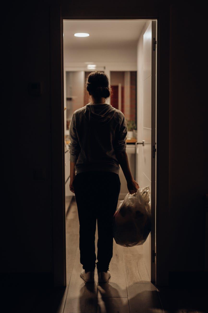 person standing near door jamb