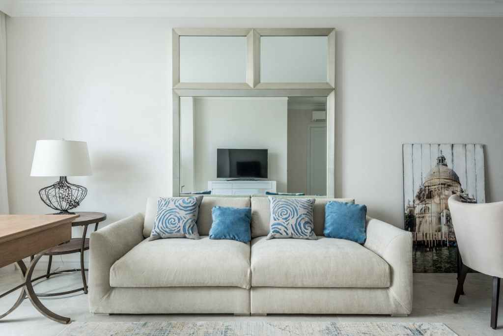 sofa with cushions in living room