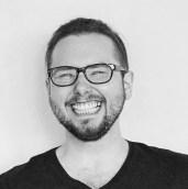 black and white image of Stephen Davidson, smiling