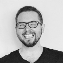 black and white photo of Stephen Davidson smiling.