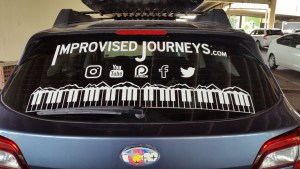 Improvised Journeys Car Logo