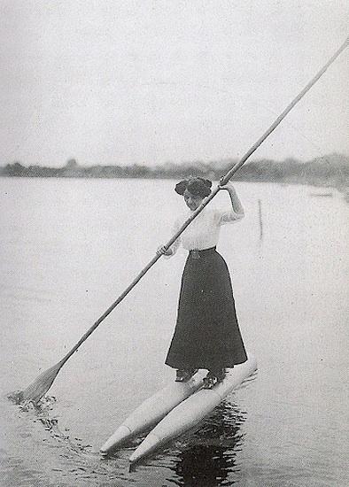 vintage photo of woman navigating lake on boat shoes