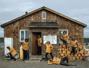 The entire crew of Team Shrub outside our island home of the Hunter and Trapper's cabin on Qikiqtaruk-Herschel Island.