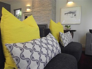 Slipper chairs with custom throw pillows