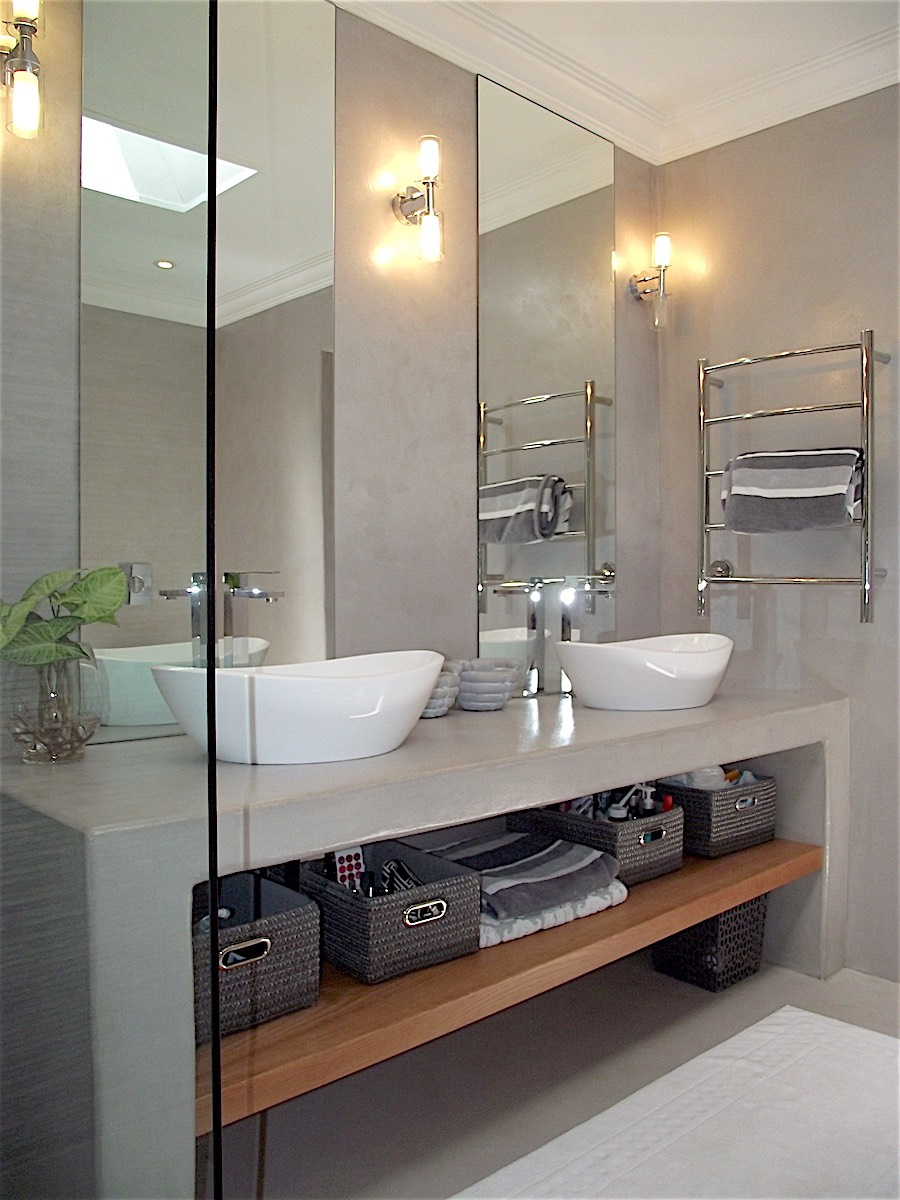 Contemporary bathroom remodel with double vessel vanity, tall mirrors and wall sconces