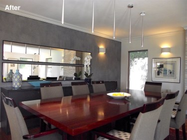 Dining room with mirrors and textured paint on focus wall after