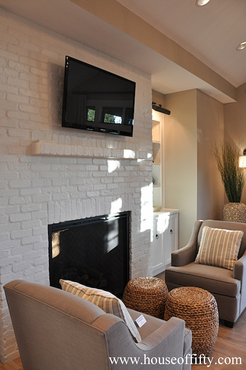 tv ridiculously high above fireplace in living room
