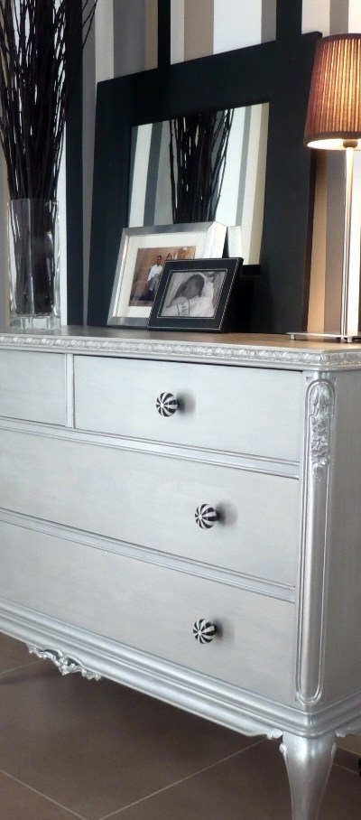 Dresser restored with a silvery grey paint and funky knobs