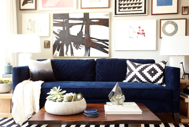 Tuxedo boxed sofa in deep blue velvet with midcentury modern chairs and fantastic gallery wall