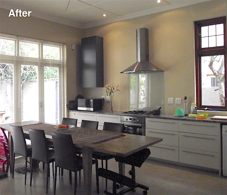 Kitchen with stacking glass doors after