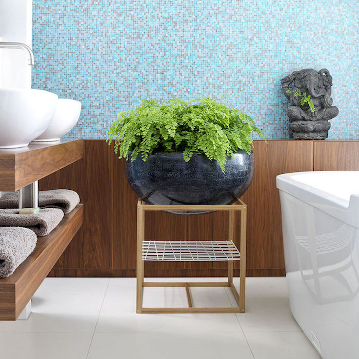 bathroom with blue tiles and large pot plant