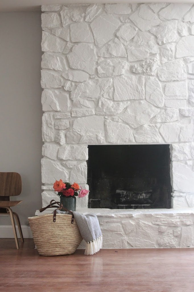 An outdated stone fireplace with a fresh look (Source)