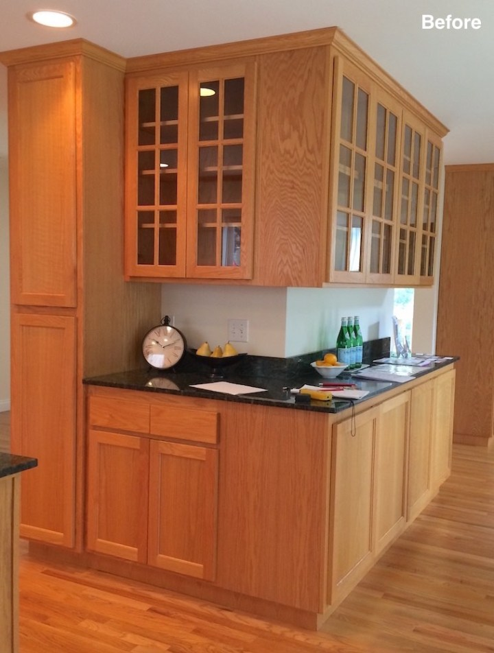 Kitchen with oak cupboards before remodel