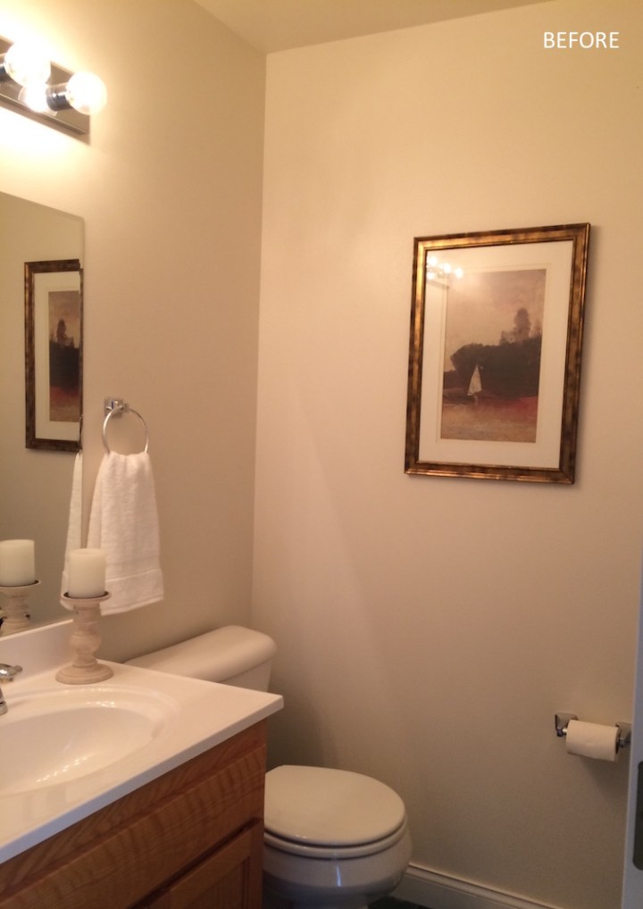 Powder room before with bland walls and bad lighting