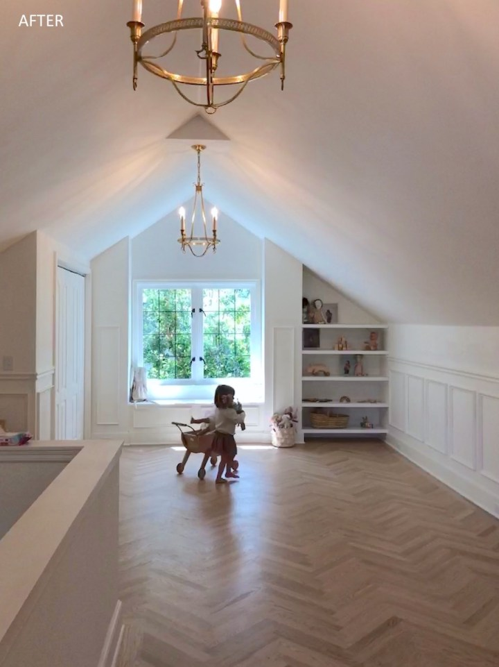 Remodeled attic playroom with pitch roof ceiling and white oak floors