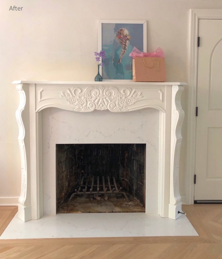 Renovated fireplace with new mantel and quartz