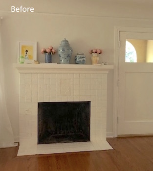 Old fireplace with painted tile surround