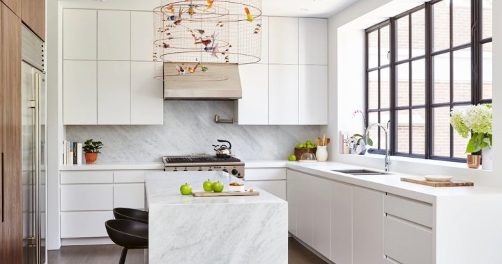 Contemporary-ktichen-with-white-cabinets-and-narrow-island-with-marble-island-top-walnut-tall-cabinet
