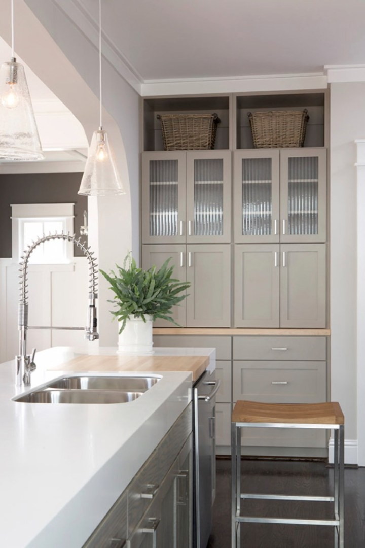kitchen-island-with-thick-white-counter-top-double-bowl-sink-and-industial-faucet-and-stained-cabinet