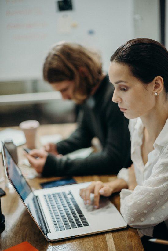 woman-using-laptop-3205546