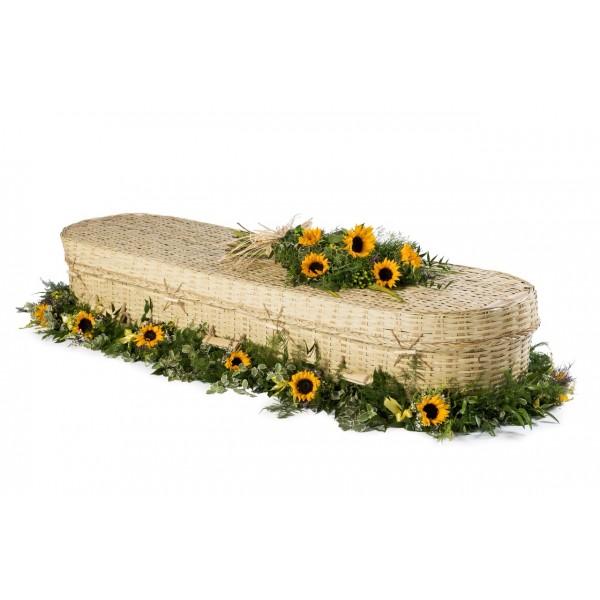 wicker coffin with sunflower spray