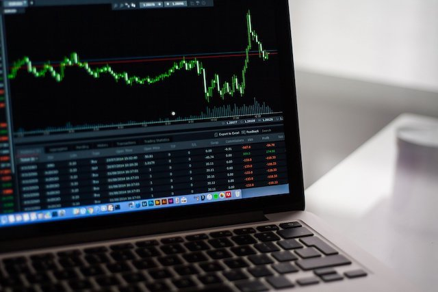 Laptop with stock market trading chart