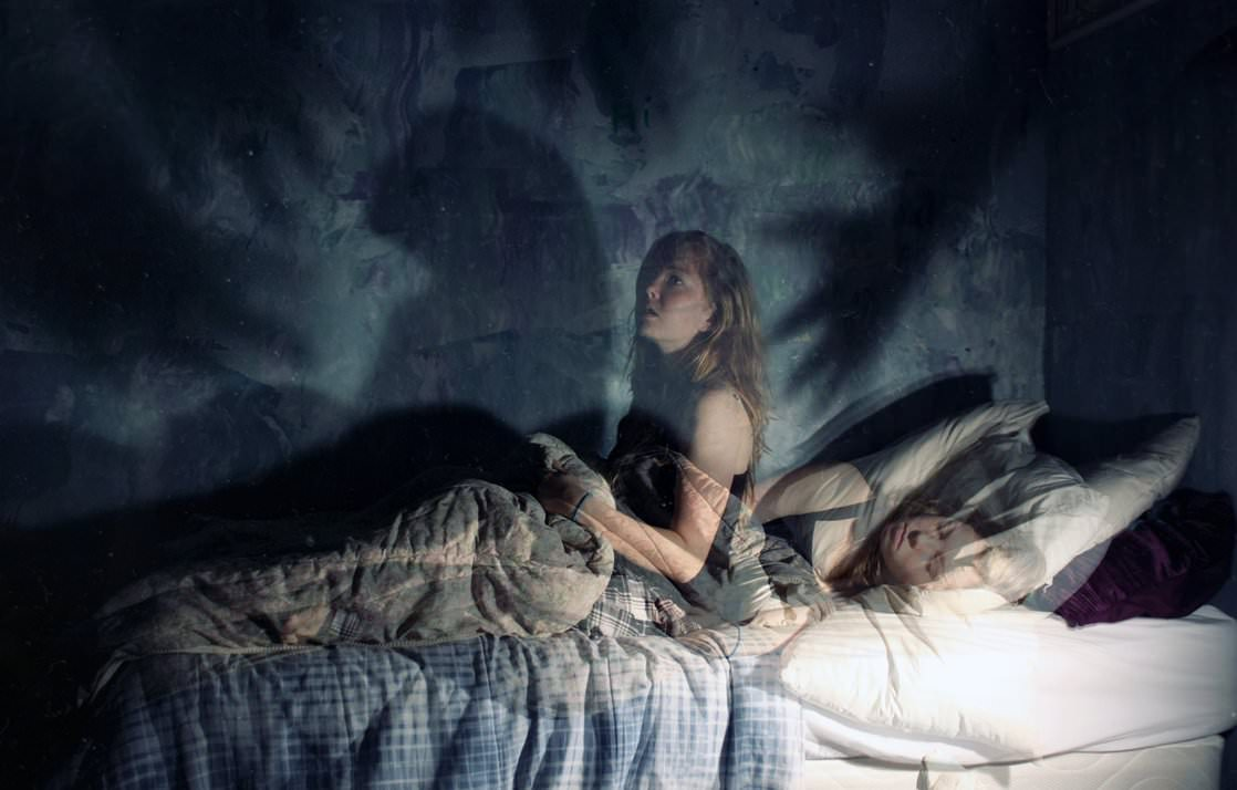 """The classic definition for this phenomenon is called sleep paralysis. It may last a few seconds, several moments, or occasionally longer and usually occurs right before you are about to fall asleep or wake up. Many people report feeling a """"presence"""" that is often described as malevolent, threatening or, evil, and usually experience a tremendous amount of terror."""
