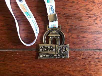 Vorderseite Medaille Neu Delhi Marathon 2019