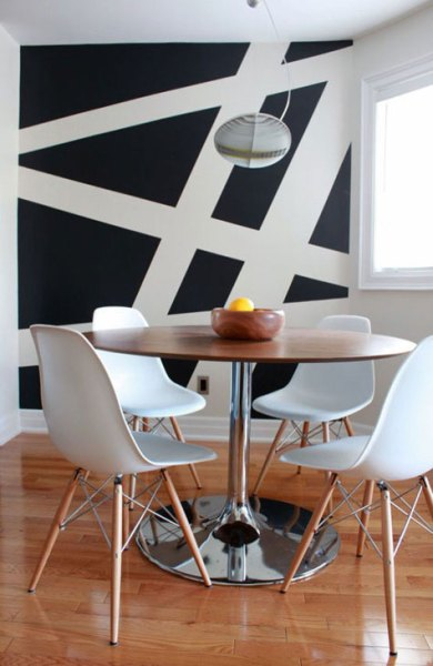 large-scale-stripes-going-all-directions-overlapping-painted-onto-wall