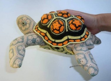 http://www.ravelry.com/patterns/library/african-flower-turtilio-gooutandinsidehome