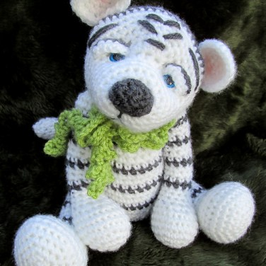 http://www.ravelry.com/patterns/library/darling-white-tiger-crochet-pattern