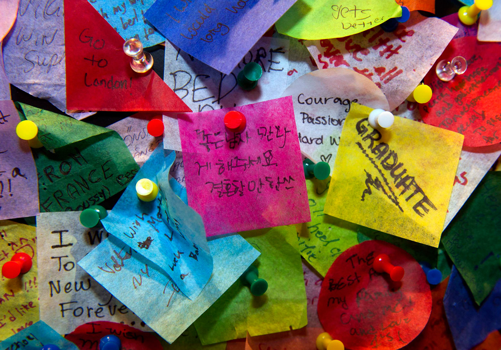 New Year's wishes for 2011 are tacked on the Carnival Cruise Lines Wishing Wall at the Times Square Visitors Center in New York, December 20, 2010. The slips of paper with people's wishes on them will be included in the confetti that will fall from the tops of buildings around the Square on New Year's Eve. (REUTERS/Ray Stubblebine/Carnival Cruise Lines) #