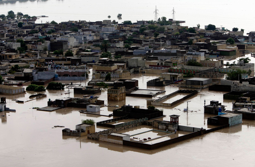An aerial view shows Nowshera city submerged in flooding caused by heavy monsoon rains in Pakistan on Friday, July 30, 2010. (AP Photo/Mohammad Sajjad)
