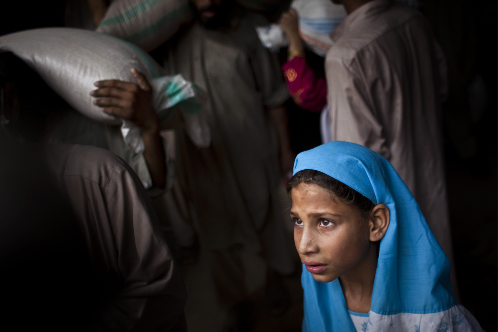 A girl waits for her turn for food at a camp in Mardan