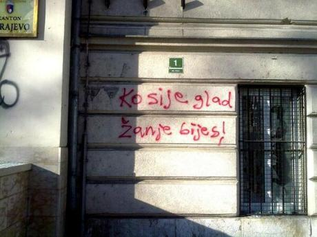 """Graffiti: """"He who sows hunger, reaps anger!"""""""