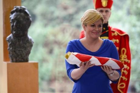 Kolinda Grabar-Kitarovic of Croatia unveils a bust monument to Franjo Tudjman Croatia's first president Photo: Goran Mehkek/Cropix