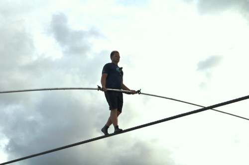 Photo of man on a tightrope