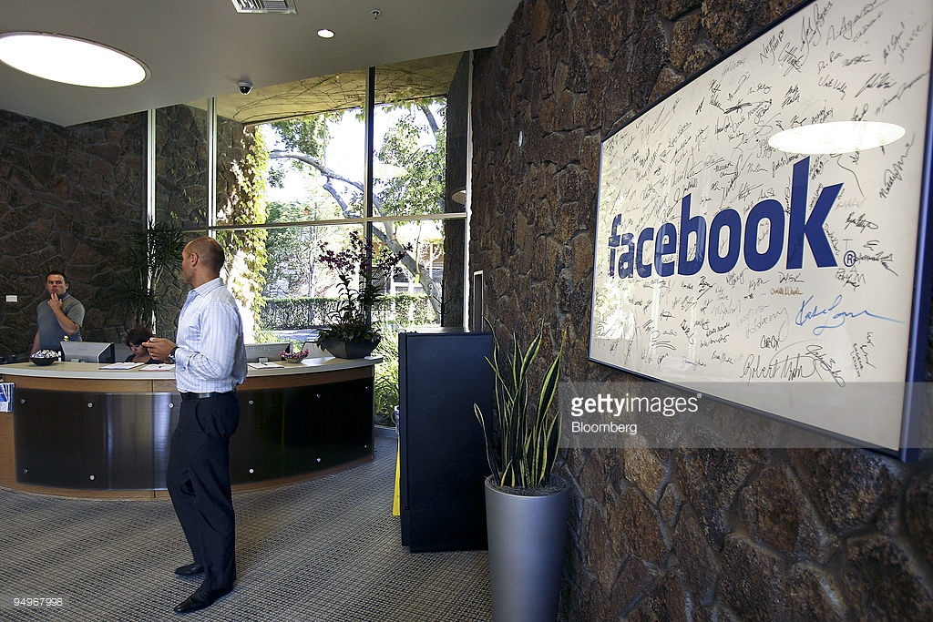Facebook sign is seen in the employees lobby entrance at Facebook headquarters in Palo Alto, California, U.S., on Tuesday, Sept. 8, 2009. Photographer: Tony Avelar/Bloomberg News