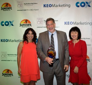 BBBSAZ CEO Laura Capello (left) and BBBSAZ board chair Christine Wilkinson (right) celebrating Quarles' President's Award with Phoenix partner Roger Morris. Photo courtesy of Big Brothers Big Sisters of Central Arizona.