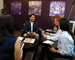 Grand Canyon University's Eduardo Borquez speaks with MBA student Natalia Diaz (left) and undergraduate business students Gianni De Bruyn and Linette Fonsea at the Colangelo College of Business. Photo courtesy of Grand Canyon University