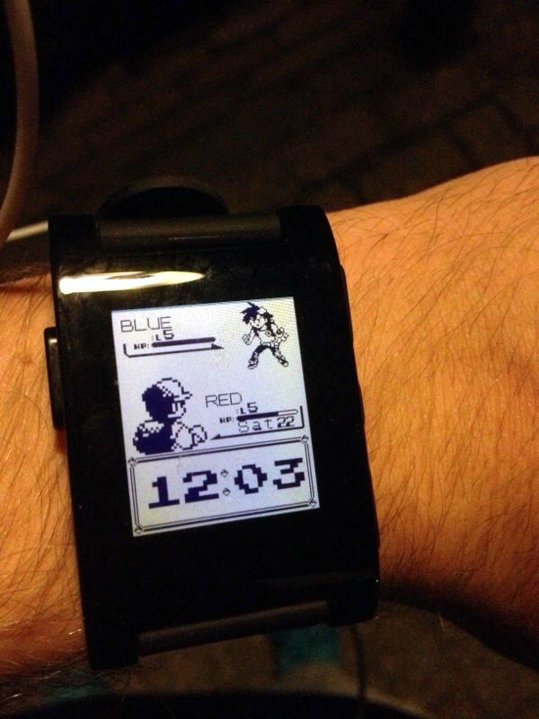 A close-up of a Pebble Watch face that resembles a screen from one of the original Pokemon games.