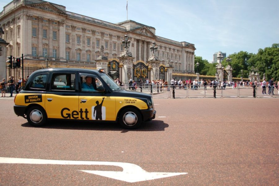 Buckingham Palace London, with  a taxi in front