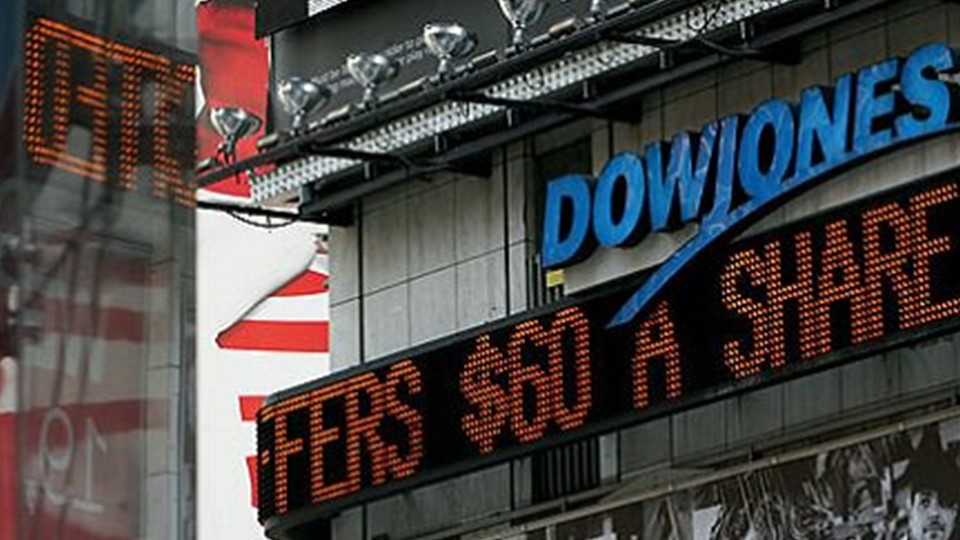The picture shows an electronic scoreboard displayed in a square with the writing Dow Jones and the quotations of the stocks that are flowing.