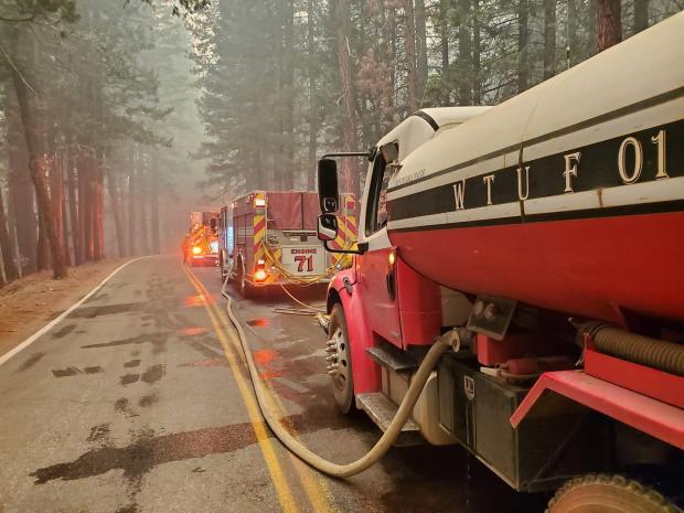 Tanker supplies water to engines in Genesee Valley