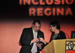 Kevin Spelay accepting Inclusion Online award for SaskTel