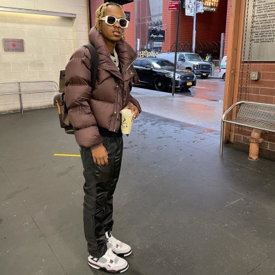 rich the kid battles the nyc rain in