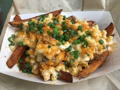 The Montford Pull-Up's cajun fries topped with mac and cheese, green onions and Cheeto dust
