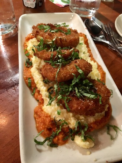 Fried Green Tomatoes with Goat Cheese Grits at Tulepo Honey Cafe